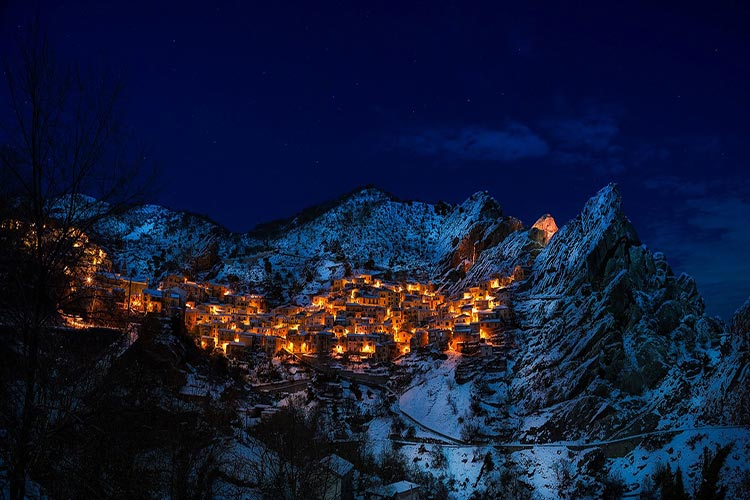 Mountains with houses lit up